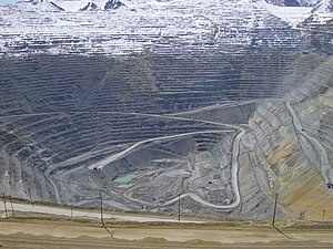 Porphyry copper deposit - Bingham Canyon mine in 2005. The gray rocks visible in the pit are almost all in the primary-sulfide ore zone.