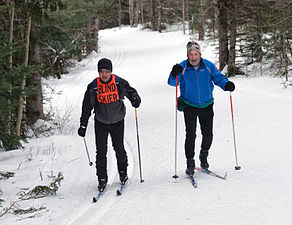 9ddf1f6b4a7 A blind cross-country skier with guide at a regional Ski for Light event.