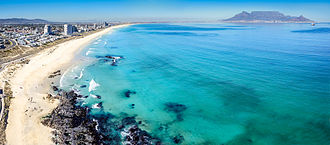 Table Bay - An aerial view of Table Bay from Bloubergstrand, to the north of Cape Town. Table Mountain is visible in the distance on the far side of the bay.