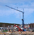 Blue construction crane.jpg