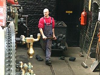 "Fireman (steam engine) - A fireman or stoker, sometimes called a ""boilerman"""