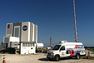 News 13 - News 13 microwave (ENG) truck at the Kennedy Space Center prior to a launch; the logo package seen here was used until August 27, 2013.