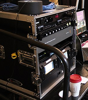 Vision mixer - A Blackmagic Design ATEM 1 M/E broadcast switcher (fourth from top of rack), rack-mounted with other equipment in a typical live production environment.  Many switchers are separated into two devices: one that does the bulk of video processing (pictured here), and a control surface used by the technical director.