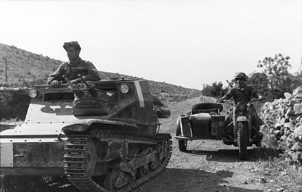 An Italian L3/35, as used during the invasion of France. This photo depicts an Italian tank and German motorbike rider during the invasion of Yugoslavia (1941). Bundesarchiv Bild 101I-201-1561-20, Balkan, italienische Panzer, Krad mit Beiwagen.jpg