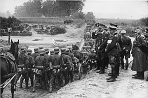 Invasion of Poland - Hitler watching German soldiers marching into Poland in September 1939.