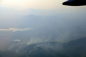 Environmental issues in Thailand - Wildfires in the Khun Tan Range, Mae Tha District, Lamphun. Every year mountain forests are set on fire by farmers to increase the yield of the valuable fungus Astraeus odoratus