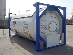 Tank container - LPG container without frame rails connecting the front and rear twistlock corners. The tank itself is the loadbearing structure between front and rear