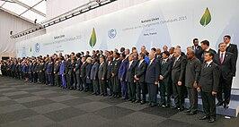 Groepsfoto van de aanwezige wereldleiders