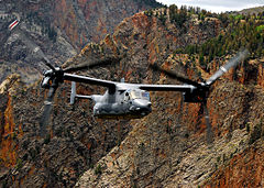 A CV-22 flying over mountainous terrain in New Mexico