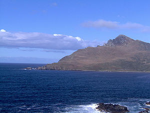 Cape Horn - Cape Horn, seen from the Chilean Navy station location. The small lighthouse can be seen as a white spot close to the seaside