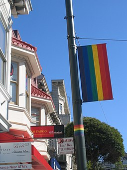The rainbow flag, symbol of LGBT pride, originated in San Francisco; banners like this one decorate streets in The Castro. Castro Rainbow Flag.jpg