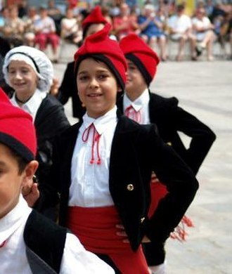 Catalans - Catalan children wearing the traditional outfit, including the barretina.