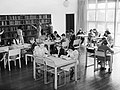 Children make use of the library in a newly constructed County School, 1945. D25741.jpg