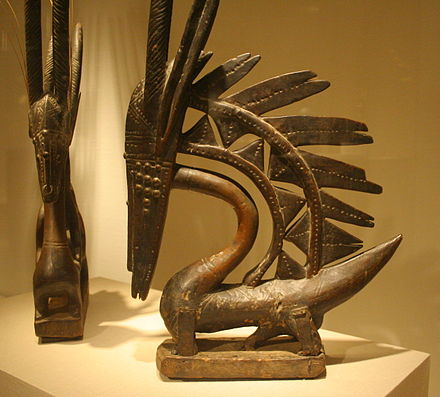 Two Bambara Chiwara c. late 19th early 20th centuries. Female (left) and male Vertical styles. Chiwara Chicago sculpture.jpg