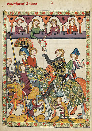 Hastilude - A knight receiving a lady's favour at a hastilude.  From Codex Manesse.