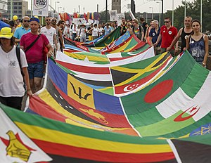 Pride parade - LGBT activists at Cologne Pride carrying a banner with the flags of 72 countries where homosexuality is illegal