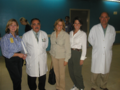 Congresswomen Blackburn, Ros-Lehtinen and Harris pose with several doctors of the pediatric hospital.png
