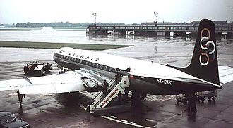 Olympic Airlines - Olympic Airways first jet aircraft type, the de Havilland Comet at Manchester Airport in 1966. The BEA codeshare logo can be partially seen on the fuselage, in red.