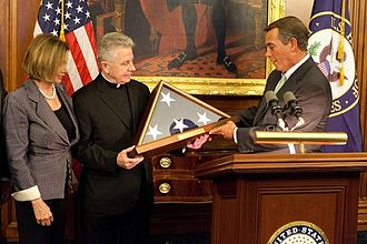 Chaplain of the United States House of Representatives - House Speaker John Boehner and Minority Leader Nancy Pelosi present a flag flown over the U.S. Capitol to Fr. Daniel Coughlin, in recognition for his 11 years of service as the 59th Chaplain of the House of Representatives, April 2011