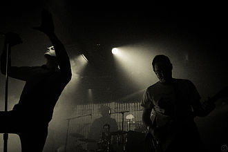 Deafheaven - George Clarke (left), Daniel Tracy (back), and Kerry McCoy (right) performing in 2013