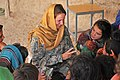 Defense.gov News Photo 100708-F-8920C-174 - U.S. Air Force 1st Lt. Georganne Hassell information operations officer of Provincial Reconstruction Team Zabul teaches Afghan girls to count at.jpg