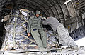 Defense.gov News Photo 110207-F-1142C-157 - Tech Sgt. Matthew Hamilton helps members of the 375th Logistics Readiness Squadron push a 500-pound pallet onto a C-17 Globemaster III at Scott Air.jpg