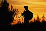 Defense.gov News Photo 111130-M-MM918-003 - U.S. Marine Corps Pfc. Garrett Reed watches over a bridge during a security patrol in Garmser district Helmand province Afghanistan on Nov. 30.jpg