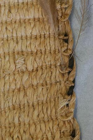 Tāniko - Detail of border of a kahu kiwi made using tāniko