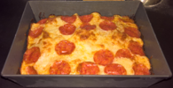 Detroit-style pizza in a traditional pan