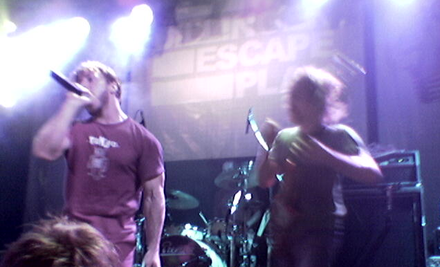 The Dillinger Escape Plan performing in Eindhoven, 2005 Dillinger Escape Plan Eindhoven.png