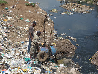 Pit latrine - Bad practice example: Fecal sludge that has been manually removed from pits is dumped into the local river at Korogocho slum near Nairobi, Kenya