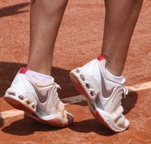 Sneakers - A pair of white athletic shoes with pink accents