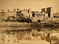 Egypt; a temple in ruins by the Nile. Photograph by Felice Wellcome V0037707.jpg
