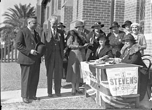 Bertram Stevens (politician) - Premier Bertram Stevens (left) at a polling place in Croydon on 13 May 1935.