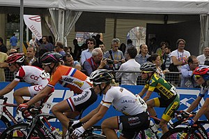 2013 UCI Road World Championships – Women's road race - The peloton in an early stage of the race. (Eugenia Bujak (white red), Ellen van Dijk (orange), Trixi Worrack (white), and Flávia Oliveira (yellow green)