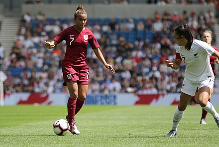 Nikita Parris (left) playing for England in 2019. England Women 0 New Zealand Women 1 01 06 2019-589 (47986413537).jpg