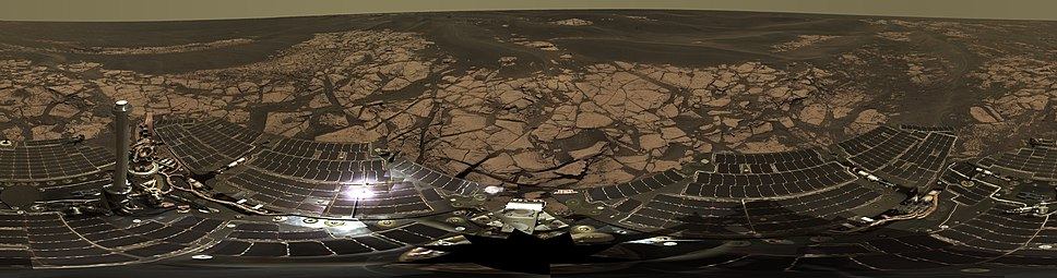Panorama taken on the rim of Erebus crater. The rover's solar panels are seen on the lower half (December 5, 2005).