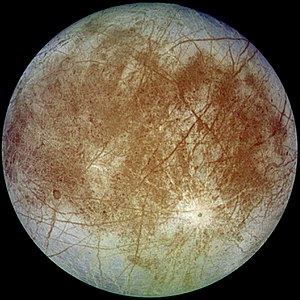 Europa (moon) - Europa's trailing hemisphere in approximate natural color. The prominent crater in the lower right is Pwyll and the darker regions are areas where Europa's primarily water ice surface has a higher mineral content. Imaged on 7 September 1996 by Galileo spacecraft.