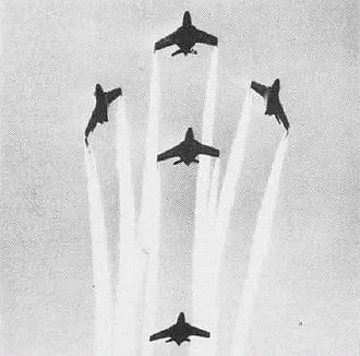 "Grumman F-9 Cougar - Blue Angel F9F-8's performing a ""fleur-de-lis"" maneuver in 1955"
