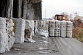 FEMA - 38937 - Cotton Bales Damaged by Hurricane Ike being moved on a loading dock.jpg