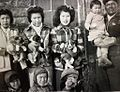 Family portrait with puppies - Cree - Pukatawagan Manitoba.1936.jpg