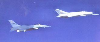 USAF Weapons School - USAF Fighter Weapons School F-16 flying with a Constant Peg MiG-21 over the Nevada desert, about 1986