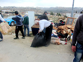 House demolition in the Israeli–Palestinian conflict - The Idris family collecting their belongings after the demolition. (Beit Hanina, 2014)