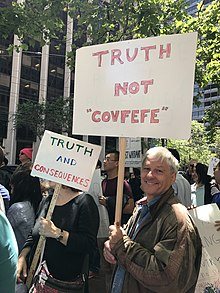 "Protester holding a 'Truth not ""Covfefe""' sign."