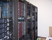 Multiple racks of servers, and how a data center commonly looks.