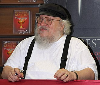 George R. R. Martin - Martin signing books in a bookstore in Ljubljana, Slovenia (June 2011)