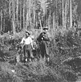 George Carmack and unidentified man, surveying the Carmack Snoqualmie gold and copper claim, accompanied by two dogs, Snoqualmie (PORTRAITS 653).jpg