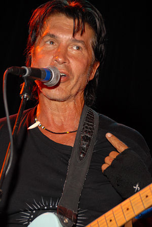 "Tapping - George Lynch in 2005 of the 1980s ""hair metal"" band, Dokken used tapping in this genre of rock music."