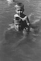 George W. Bush swimming with Jeb on his back June 1956 (2843).jpg