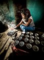 Girl preparing coffee ceremony, Lalibela.jpg